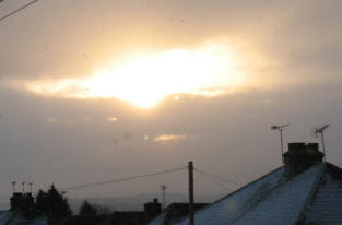 Pitmans Shorthand Christmas Carols: Dawn sun and snow shower over Orpington, Kent